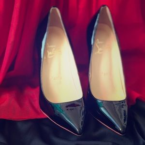 Christian Louboutin patent leather red-sole pump